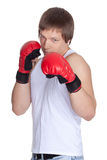 Sporty man  in red fighting gloves. Stock Images