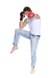 Sporty man  in red fighting gloves. Royalty Free Stock Photos