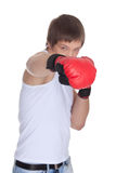Sporty man  in red fighting gloves. Royalty Free Stock Image