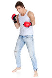 Sporty man  in red fighting gloves. Stock Image