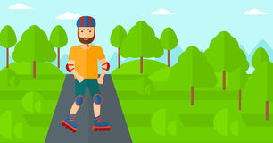 Sporty man on roller-skates. Royalty Free Stock Image