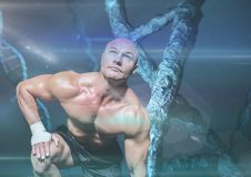 Sporty man with stone dna chain and blue lights Royalty Free Stock Photography