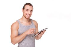 Sporty man with tablet computer Royalty Free Stock Photography