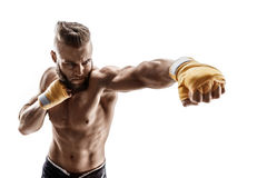 Sporty man throwing a fierce and powerful punch. Photo of muscular man isolated on white background. Strength and motivationAthletic boxer throwing a fierce stock images