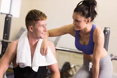 Sporty man and woman chatting in gym Stock Photos