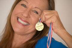 Sporty mature woman with medal Royalty Free Stock Photos