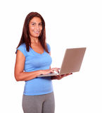 Sporty mature woman using her laptop computer Stock Image