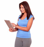 Sporty mature woman using her tablet pc Stock Images
