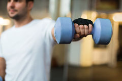 Sporty men hands with light blue dumbbells Royalty Free Stock Images