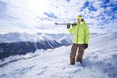 Sporty men with skis in a snow mountain resort Stock Image