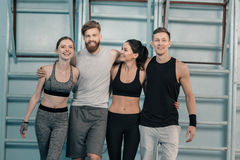 Sporty men and women in gym. Cheerful sporty men and women in gym Royalty Free Stock Image