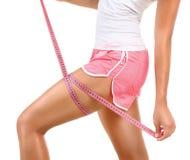 Sporty model girl measures her leg stock photo