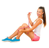 Sporty model girl measures her leg Stock Image