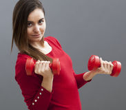 Sporty motivated lady keeping fit Royalty Free Stock Images