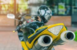 A sporty motorcycle parked. In front of a coffee shop stock images