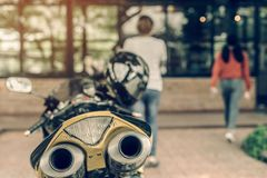 A sporty motorcycle parked. In front of a coffee shop royalty free stock photography