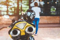 A sporty motorcycle parked. In front of a coffee shop stock photography