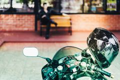 A sporty motorcycle parked. In front of a coffee shop royalty free stock photos