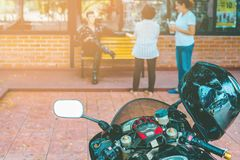 A sporty motorcycle parked. In front of a coffee shop stock photos