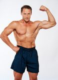 Sporty muscle man in shorts Royalty Free Stock Photos