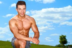 Sporty muscular man at field Stock Photography