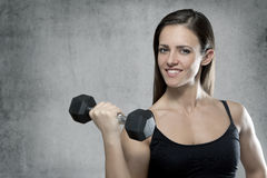 Sporty muscular woman with dumbbell Stock Photos