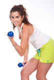 Sporty muscular woman working out Stock Images