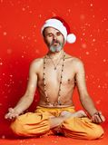 Christmas senoir in lotus pose meditating stock images