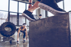 Sporty people exercising at cross fit gym workout. Close-up partial view of sporty people exercising at cross fit gym workout Stock Images