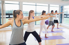 Sporty people stretching hands at yoga class Royalty Free Stock Photos
