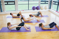 Sporty people stretching hands at yoga class Stock Image