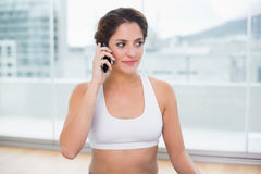 Sporty pleased brunette phoning Royalty Free Stock Images