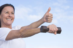 Sporty positive mature woman outdoor Royalty Free Stock Photos