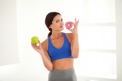 Sporty pretty lady deciding on food diet Stock Photos