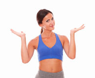 Sporty pretty woman raising palms up Royalty Free Stock Images