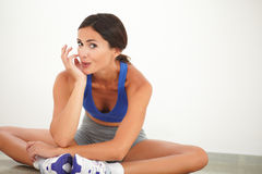 Sporty pretty woman sitting for relaxation Stock Images