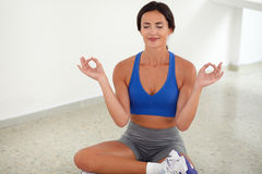 Sporty pretty woman smiling with closed eyes. In yoga class Royalty Free Stock Images