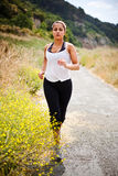 Sporty running woman. A beautiful asian woman running in a park Stock Photo