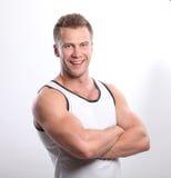 Sporty seksowny mężczyzna pozuje w gym Zdjęcie Royalty Free