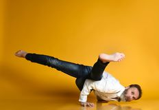 Sporty senior man doing Arm balance exercise for strength, yoga, pilates training, stock photography