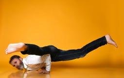 Sporty senior man doing Arm balance exercise for strength, yoga, pilates training, stock photo