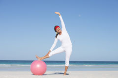 Sporty senior woman active at beach Stock Photo