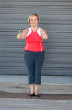 Sporty senior woman giving a double thumbs up Royalty Free Stock Photo