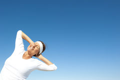 Sporty senior woman sky background Stock Image