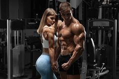 Free Sporty Sexy Couple Showing Muscle And Workout In Gym. Muscular Man And Woman Royalty Free Stock Images - 158669519