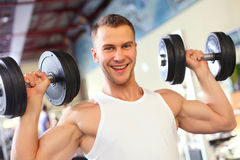 Sporty sexy man posing in gym Royalty Free Stock Image