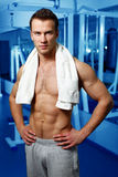 Sporty sexy man posing in gym Stock Images