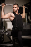 Sporty sexy men with great abdominal muscles in black sportswear. Sporty sexy man with great abdominal muscles in black sportswear Royalty Free Stock Images