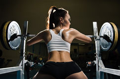 Sporty sexy woman in gym. Sporty sexy strong woman in gym Royalty Free Stock Photos