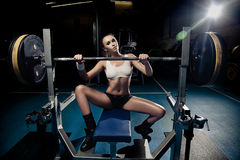 Sporty sexy woman in gym Royalty Free Stock Image